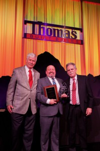Dean August accepting award at 2019 Thomas Built Buses' Dealer Meeting