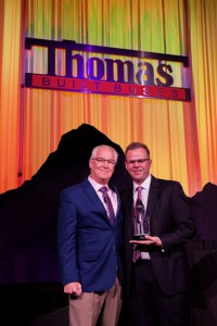 Guy accepting award at 2019 Thomas Built Buses' Dealer Meeting